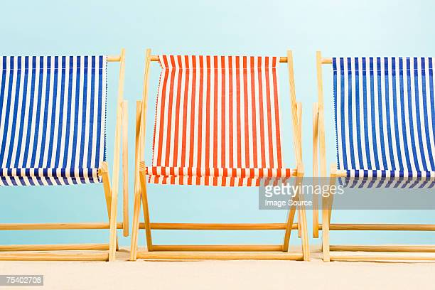 three deckchairs - outdoor chair stock pictures, royalty-free photos & images