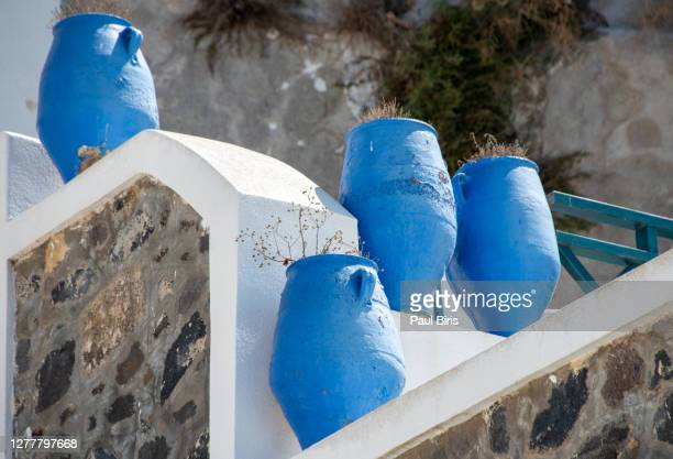 three deep blue greek urn's on a patio , fira, santorini, greece. - europa meridionale foto e immagini stock