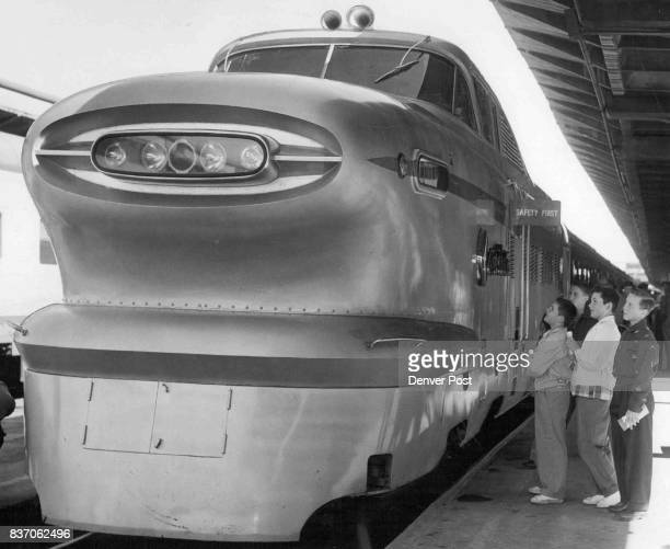 Three Denver youngsters look over the power unit of the train From left to right they are John Kirby of 264 S Lafayette St his brother Eddie and...