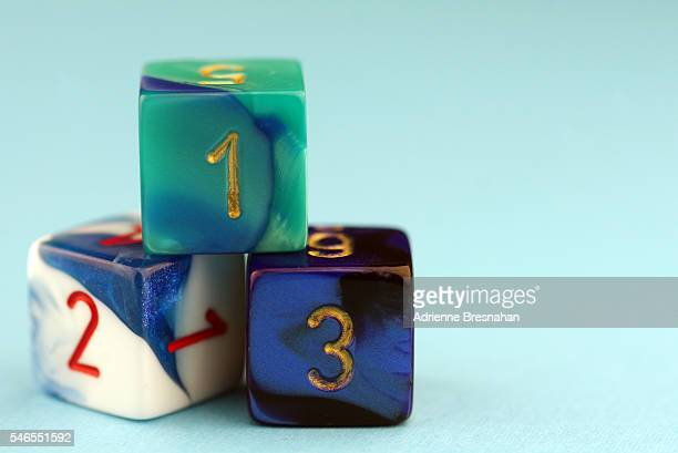 Three Dice With Arabic Numerals on Blue Background
