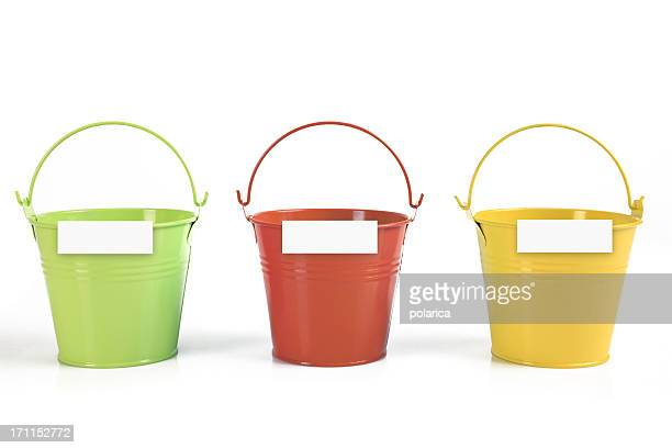 Three different colored buckets with handles