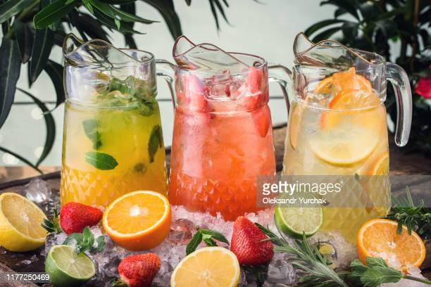 three different jugs of lemodane refreshing drink - pitcher stock pictures, royalty-free photos & images