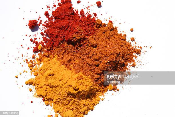 three different powdered spices in a white background - curry stock pictures, royalty-free photos & images