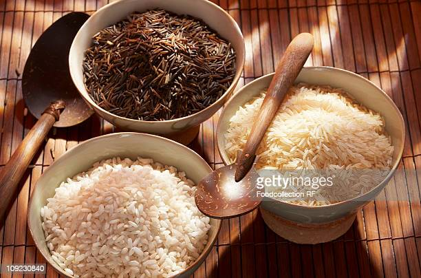 Three different types of rice in bowls, close-up