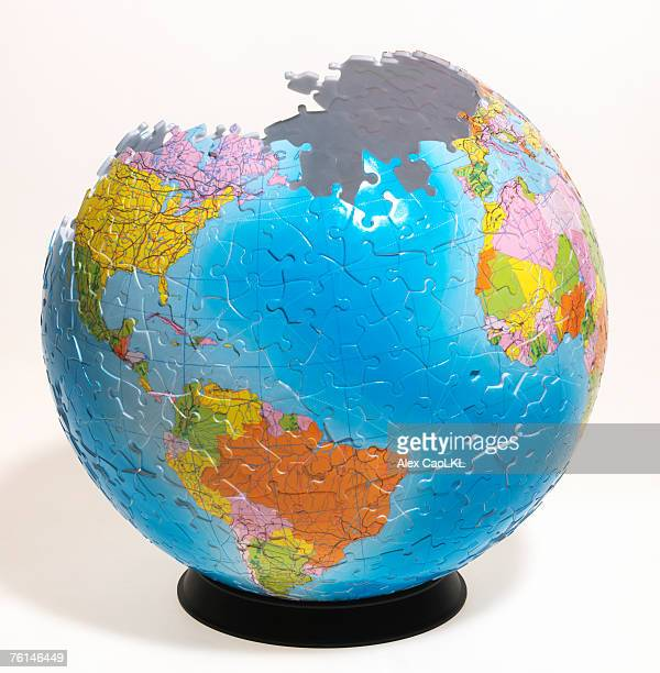 Three dimensional globe puzzle almost complete (digital composite)