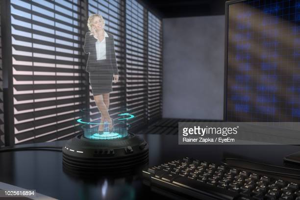 three dimensional hologram image of businesswoman standing on technology - hologram stock pictures, royalty-free photos & images