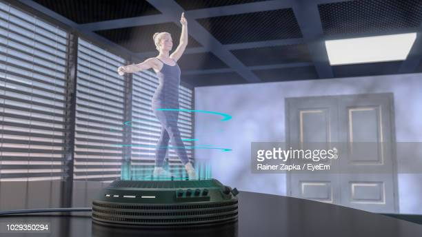 three dimensional hologram image of woman dancing on technology - hologram stock pictures, royalty-free photos & images