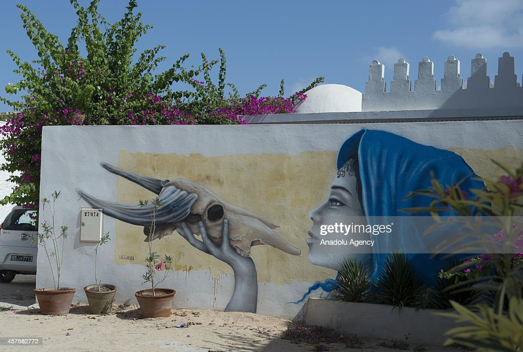 A three dimensional picture on a wall is seen in Djerba island of Tunisia, on October 17, 2014. Three dimensional pictures painted by the 150 street performers from 30 countries attract tourist attention in Djerba, Tunisia. Pictures on the walls are about the Western and Islamic cultures as well as the developments in the world.