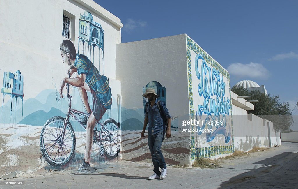 Three dimensional pictures on the walls are seen in Djerba island of Tunisia, on October 17, 2014. Three dimensional pictures painted by the 150 street performers from 30 countries attract tourist attention in Djerba, Tunisia. Pictures on the walls are about the Western and Islamic cultures as well as the developments in the world.