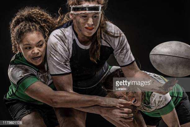 three dirty female rugby players - rugby league stock pictures, royalty-free photos & images