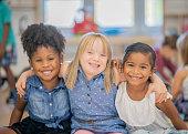 Three diverse friends at kindergarten