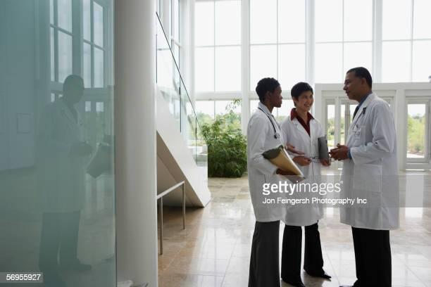 Three doctors conferring