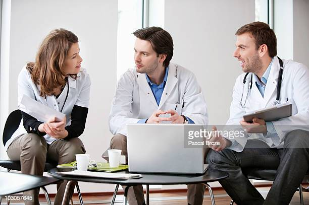 Three doctors talking to each other