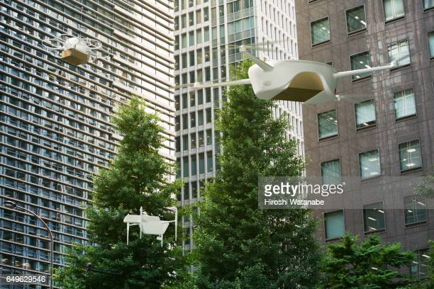 Three drones flying among office buildings