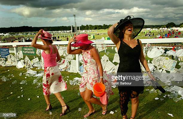 Three drunk racegoers make their way home after the last race of the third day of the Royal Ascot horse racing week June 19 2003 in Ascot England...