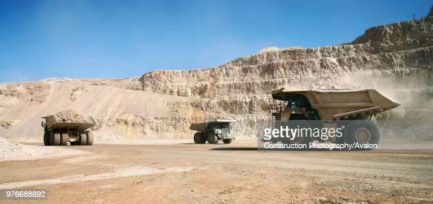 Three Dumper Trucks moving in Escondidas copper open cast mine Chile