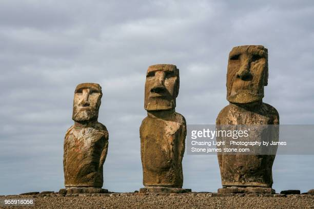 three easter island head statues - easter island stock pictures, royalty-free photos & images