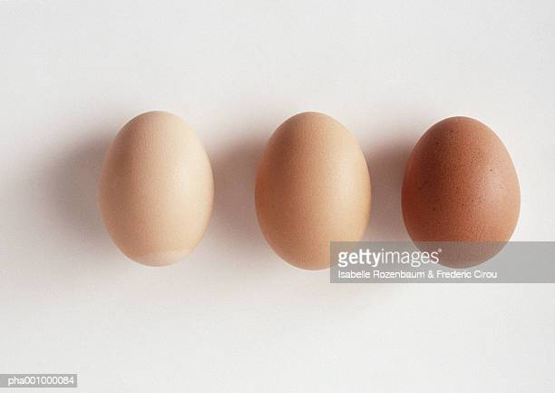 three eggs against white background, close-up - small group of objects stock pictures, royalty-free photos & images