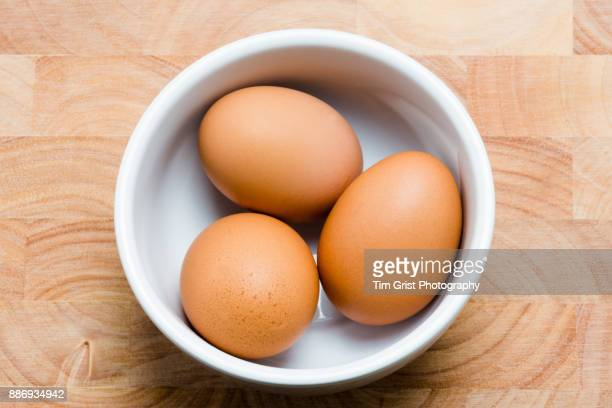 Three Eggs in a White Bowl