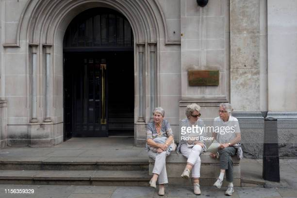 Three elderly ladies rest outside parliamentary offices on Whitehall on 15th July 2019 in London England