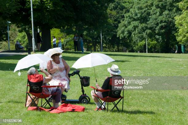 Three elderly people meet in Dane Park - they are social distancing but able to get out and enjoy the fine weather following the easing of...