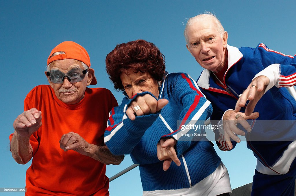 Three elderly people posing as youth : Foto de stock