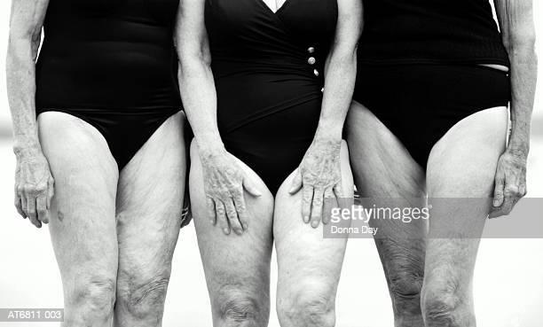Three elderly women in swimwear, mid section (B&W)