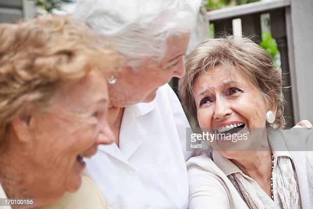 Three elderly women laughing