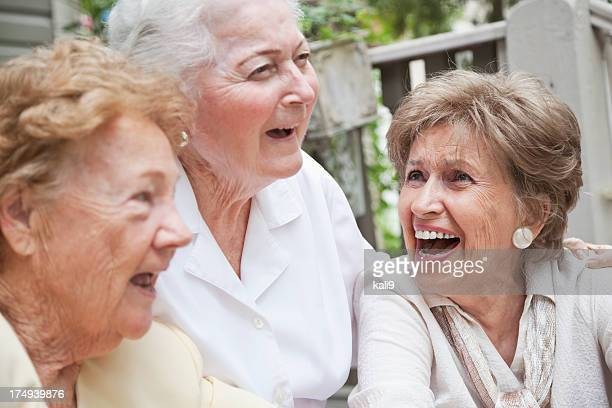 Three elderly women laughing