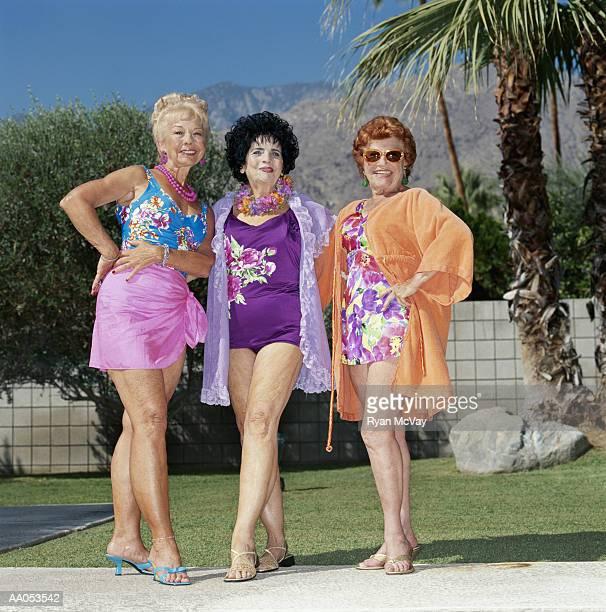 Three elderly women standing outdoors, smiling, portrait
