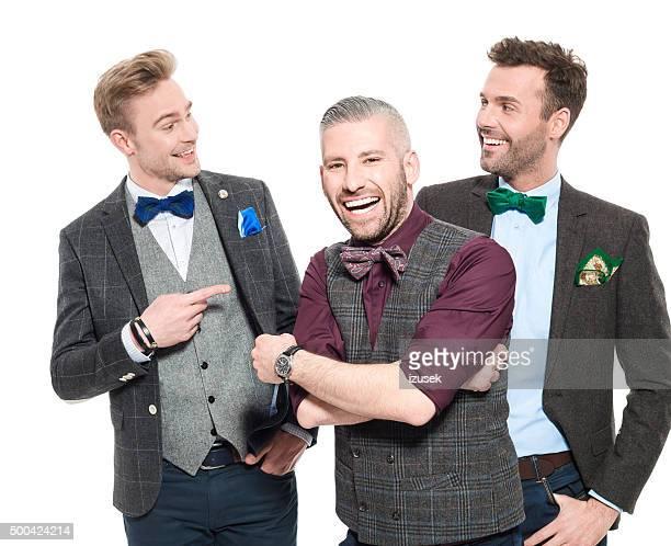 Three elegant businessmen in retro style outfit