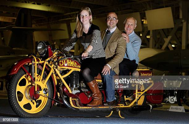 Three employees of Bonhams auction house sit on a 3seater 1937 Bohmerland 603cc Langtouren motorbike in the RAF Museum ahead of their sale of 100...