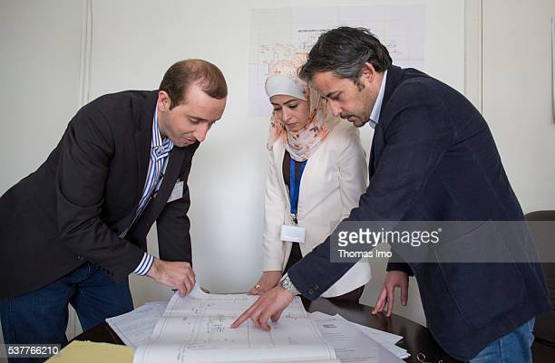 Three employees of the Jordanian Ministry of Water Supply are planning infrastructure of water on April 06 2016 in Amman Jordan
