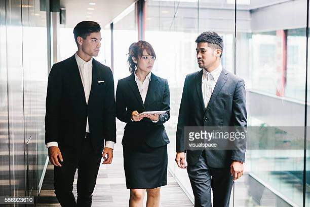 three entrepreneurs briefing in the office - 日本人のみ ストックフォトと画像