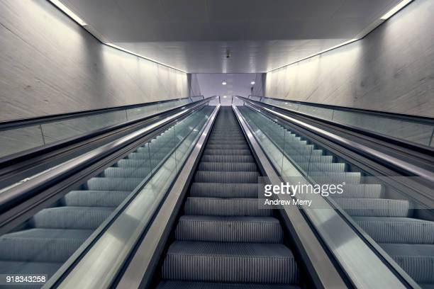 three escalators looking upward, zurich central station, switzerland - escalator stock pictures, royalty-free photos & images