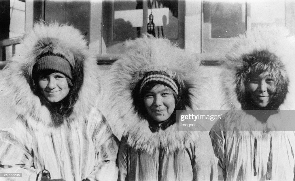 Three Eskimo girls wearing their chubby parkas: Wolfskin around their faces should protect them from wind, snow and cold. Photograph. Around 1935. : News Photo