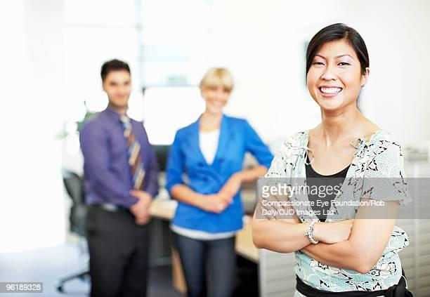Three executives smiling, portrait