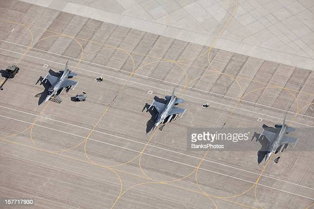 three f-16 fighter jets on tarmac ready for flight - military airplane stock pictures, royalty-free photos & images