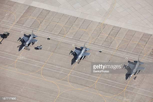 Three F-16 Fighter Jets on Tarmac Ready for Flight