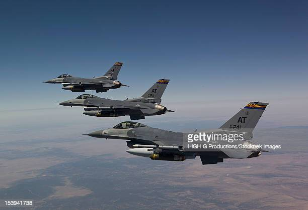 Three F-16's from the Air National Guard Air Force Reserve Test Center fly in formation during a test mission out of Tucson International Airport, Arizona.