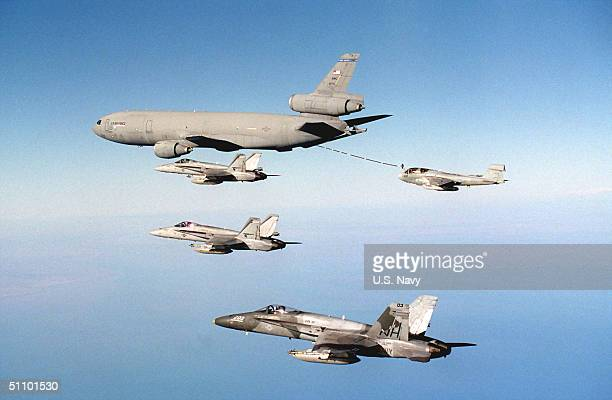 Three F/A18 Hornets From Strike Fighter Squadron Nine Four And An E/A6B Prowler From Electronic Counter Measures Squadron One Three Five Conduct...