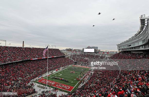 Three F/A-18 jets perform a flyover before the start of the Maryland Terrapins at Ohio State Buckeyes football game at Ohio Stadium on November 9,...