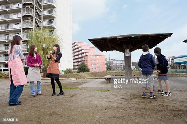Three families chatting