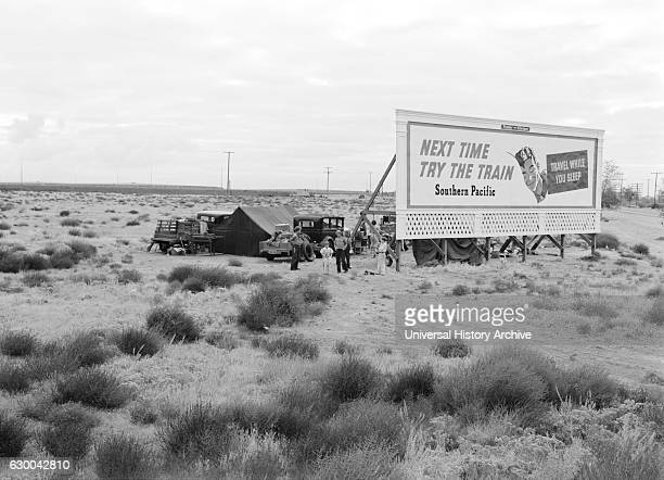 Three Families Looking for Work Camped Behind Billboard, U.S. 99, California, USA, Dorothea Lange for Farm Security Administration, November 1938.