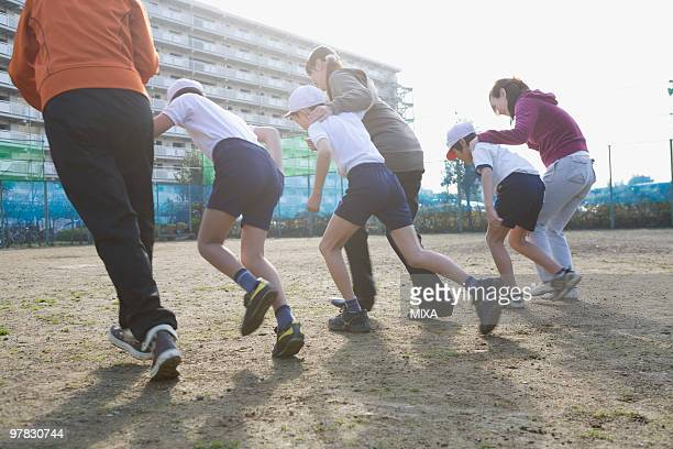Three families running foot race