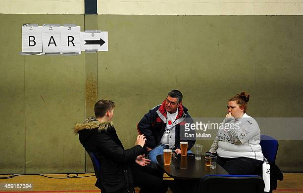 Three fans enjoy some prematch drinks ahead of the FA Cup First Round match between WestonSuperMare and Doncaster Rovers on November 18 2014 in...
