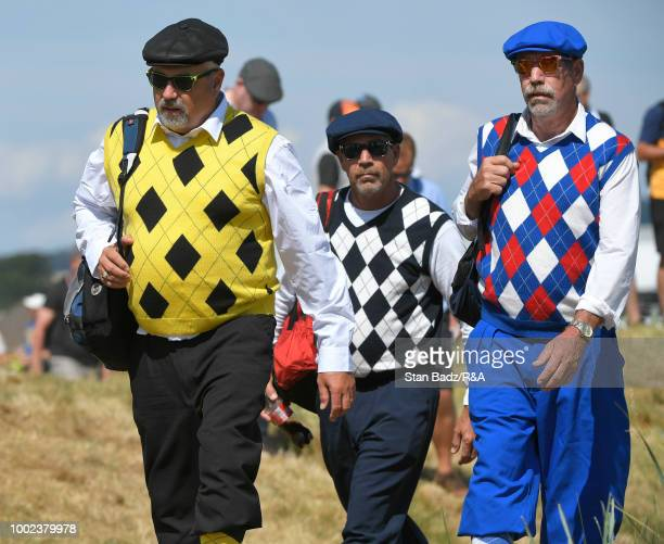 Three fans walks along the first hole during the first round of the 147th Open Championship at Carnoustie Golf Club on July 19 2018 in Angus Scotland