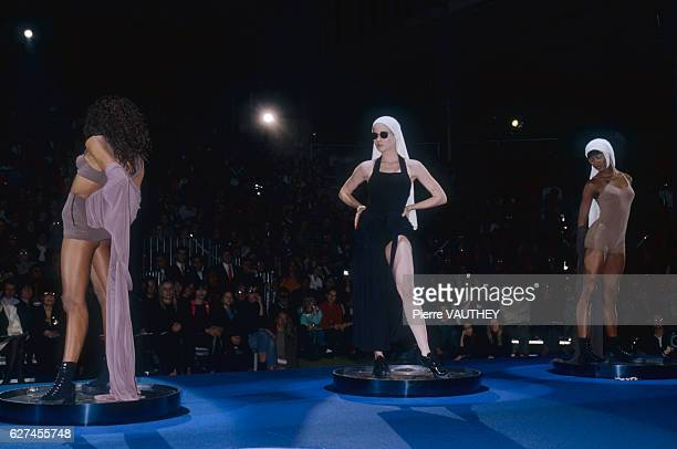Three fashion models including Naomi Campbell wear readytowear beach outfits by French fashion designer Jean Paul Gaultier They modeled the outfits...