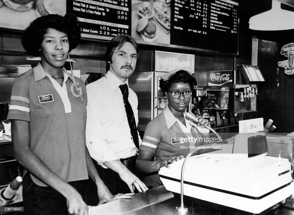 Three fast food restaurant employees are at the counter, Baltimore, Maryland, 1970.