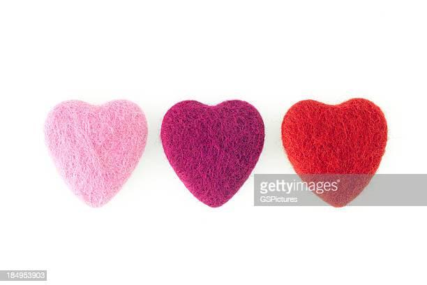 Three felt hearts in a row